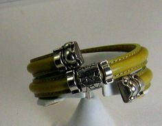 Double Memory Wire Mini Regaliz Bracelet in Olive. A smart and classic style in a women's leather bracelet
