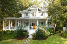 13 pretty porches ... love this pop of color on this front door! | Living the Country Life | http://www.livingthecountrylife.com/homes-acreages/country-homes/13-pretty-porches/