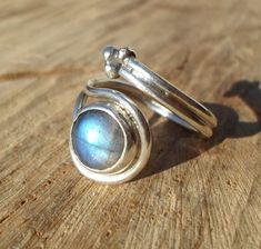 labradorite ring-blue labradorite ring-statement sterling silver ring-wire silver ring-energy stone ring-adjustable ring by ARTEAMANOetsy on Etsy Blue Rings, Silver Rings, Labradorite Healing Properties, 925 Silver, Sterling Silver, Labradorite Ring, Adjustable Ring, Statement Rings, Beautiful Rings