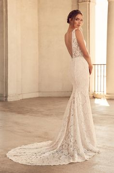 Style 4792   Paloma #Lace #WeddingDress. Paloma Lace bodice with plunging neckline and beaded edging around neckline and waist. Fit and flare lace skirt with scalloped hem.