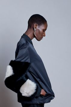 Anne Vest bomber jacket and Malin Ljung Jewelry earrings. Styled by Marie Olsson Nylander, Monica Daxberg and Malin Ljung. Photo by Særún Norén.