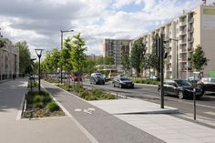 Complete street in the Mermoz sector of Lyon, France by Gautier+Conquer Architectes. Click image for full profile & visit the slowottawa.ca boards >> http://www.pinterest.com/slowottawa/