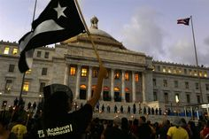 Puerto Rico is warning state and federal officials it's about to run out of Medicaid funds while Puerto Ricans in the U.S. protest an austerity plan.