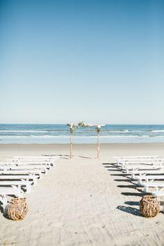 Pristine beach ceremony: http://www.stylemepretty.com/north-carolina-weddings/2015/04/20/fall-beach-wedding/ | Photography: Kaytee Lauren http://kayteelauren.com/