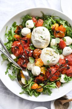 Just a picture! Fresh mozzarella and bocconcini, roasted red, orange and yellow tomatoes over a bed of lettuce (arugula?).