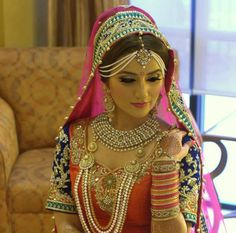 Indian bride wearing bridal lehenga and jewellery. #IndianBridalHairstyle #IndianBridalMakeup #IndianBridalFashion #BridalPhotoShoot