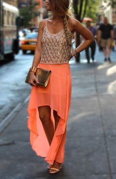 High low skirt + sparkly top + metallic clutch