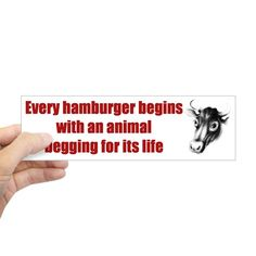This bumper sticker depicts a black and white cow with the caption, Every hamburger begins with an animal begging for its life. Great gift idea for an animal rights activist!