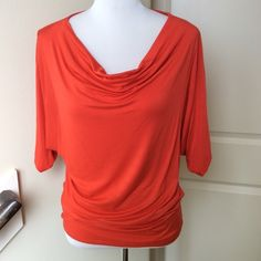 Bobeau Orange Top Beautiful orange top with round drape front, blouson style and gathers at the hem. 95% Rayon / 5% Spandex. Size M and in good condition. bobeau Tops Blouses