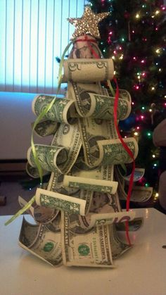 Money really does grow on this tree. Use a curling iron at the bottom of the bills and a foam tree base for a creative way to give cash.
