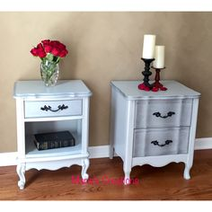 Pair of French Provincial nightstands dressed in shimmery silver and grey.  18x14x24 and 19x17x24 $265