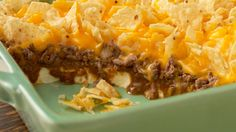 Chili Cheese Bake    Ingredients:   2 (8-oz.) pkg. cream cheese   2 small cans chili with no beans   1 lb. lean ground beef, cooked   1 bag TOSTITOS® Restaurant Style Tortilla Chips, coarsely crushed   1 (12-oz.) bag shredded cheddar and/or Monterey Jack cheese