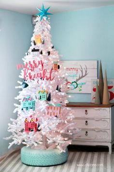 DIY Recycled Tire Christmas Tree Base | Who uses a tire as a Christmas tree base!? WE DO!  Loving our freshly painted aqua Recycled Tires for our Christmas Village Tree!