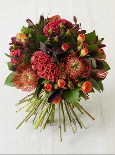 coxcomb and the addition of pin cushion proteas = unusual Fall bouquet