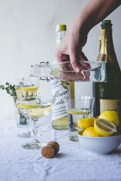 Elderflower and Thyme Cocktail -  Elderflower Cordial, Prosecco/Champagne/Sparkling Water, Aquavit or Gin, Thyme, Lemon Slices.