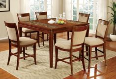 Counter Ht. Table With 6 Chairs 7 Pc. Emmett II Collection Cm3436PtAdd a bit of fl air into your dining room withthis unique table show casing a coconut shellwoven design under a tempered glass insert.Padded fabric chairs with a neutral colorfabric accompany the table, making this setfit perfect for any dining room.• Transitional Style• Coconut Shell Inserts• Padded Fabric Chairs• Tempered Glass Top• Solid Wood, Wood Veneer