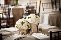 Hydrangea and hypericum berries fill these birch vases with elegance...