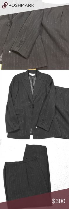 PANTS SUIT BLACK W/SILVER PINSTRIPES BEAUTIFUL Great pants suit. Paper tag fell off but the plastic one is still on the sleeve. The thread came out on the slide closure to the top of the pants. It takes nothing to put a stitch in it. It doesn't affect the pants at all in quality Tahari by Arthur Levine Jackets & Coats Blazers