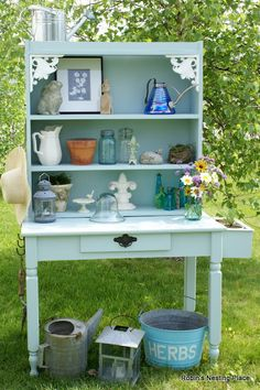 INGENUITY -  potting bench - a clever blogger refurbished a beat up table top with bed slats - flipped a book shelf upside down - for the hutch!