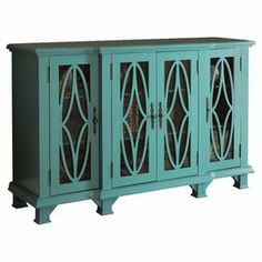 An eye-catching addition to your living room or entryway, this stylish sideboard showcases 4 doors and ample interior shelving.