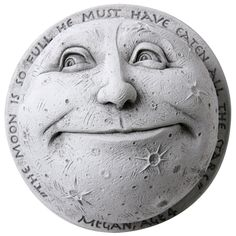 """Inspired by the imagination of a 4-year-old named Megan, American sculptor George Carruth designed this plump, contented moon. Engraved all around are Megan's words: """"The moon is so full it must have eaten all the stars."""" Hand-cast in stone with a moon-white finish, plaque arrives ready to hang from a sturdy wire on back. Enjoy indoors or out"""
