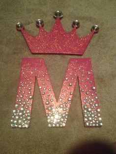 Letters painted and modge podged before adding glitter. Hobby lobby gems added after finishing.