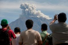 A rumbling volcano on Indonesia's tourist island of Bali ejected greyish-white plumes of ash on Friday, a timelapse sequence of Reuters images showed, a reminder, if it were needed, that its weeks-long period of activity has not ended.