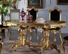 chaise baroque en bois doré tapissée de tissu noir et table à manger assortie
