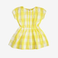 This comfy dress in a cheery lemon yellow plaid is comfy and casual enough for school or everyday play. Easy elastic waist, front pleats, cap sleeves and buttons at shoulders. Perfect with leggings or