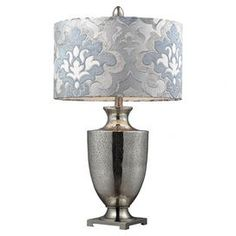 """Invite fresh spring style into your home with this eye-catching design, artfully crafted for lasting appeal.   Product: Table lamp    Construction Material: Glass and fabric    Color: Antiqued mercury glass, blue-gray damask and polished chrome     Features: 3-Way switch      Accommodates: (1) 150 Watt medium base bulb - not included    Dimensions: 31"""" H x 17"""" Diameter"""