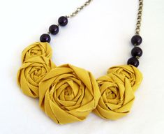 Yellow and deep purple Rosette Necklace from 'Miss Betty Lou' on Esty. Chic!