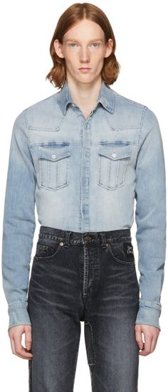 e8c9876068f This denim shirt by PIERRE BALMAIN has a lean silhouette with touches of  tailoring from the