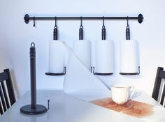 I don't need four of them but like this hanging paper towel holder as part of the FINTORP Series at Ikea
