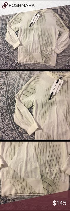 Dkny off white geo stripe long sleeve knit top NWT $295 DKNY abstract / geo printed long sleeve top with stripes. Base color is an off white with gray and black details. 100% cotton. Size large. This is very modern and trendy. Great item. No trades DKNY Tops