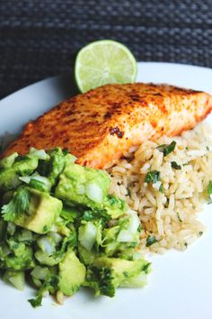 Easy chile lime, butter basted salmon filets with cilantro lime rice and a refreshing avocado salsa. The perfect easy recipe for Lent! Avocado Rice, Salmon With Avocado Salsa, Salmon And Rice, Spicy Salmon, Cilantro Lime Rice, Sides With Salmon, Lime Salmon Recipes, Avocado Recipes, Salad Recipes For Dinner