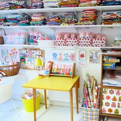 fabric and product organization in a craft room! So inspiring!