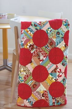 The red circles in this quilt are bursting with energy and color, this is one happy quilt.