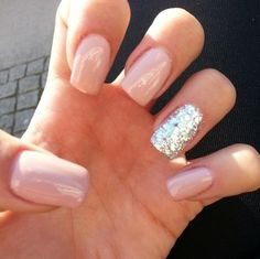 nude polish, plus one sparkly nail - love this!