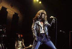 Joey Ramone performs with rock n roll band, The Ramones, in the 1990s.