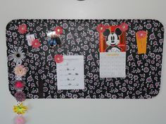 DIY - Magnetic Board - Materials: oil drip pan (less than ten dollars), 3M picture hanging strips, some mod podge, and fabric to cover it. Directions with pictures.