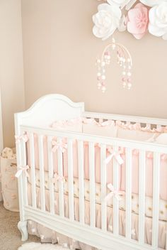 Pottery Barn Crib and Pink + Ivory decor...