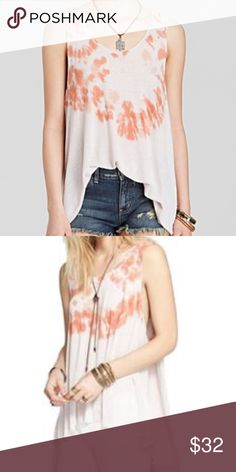 NWT Free People tie dye tank! NWT! Superbly soft jersey tank flaunts a flowing cape back. Round neckline and sleeveless construction. Subtle tie-dye print. Pull-on design. Curved hemline. 70% rayon, 30% linen. I'll add more pictures in a few hours! Free People Tops