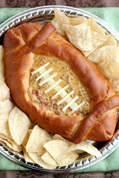 This Football Dip Bowl is made with a frozen whole wheat dough that is shaped into a football with a place to hold your favorite queso dip! Make laces with cut up string cheese and you have a football themed party food! (Step-by-step photos included. Healthy Snacks For Kids, Easy Snacks, Yummy Snacks, Appetizer Dips, Appetizer Recipes, Bowl Desserts, Tailgating Recipes, Football Recipes, Football Food