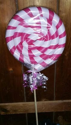 Lollipop Lawn Decoration made from a Swim Noodles & Duct Tape!