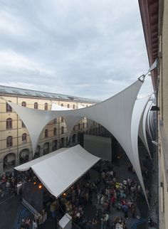 """AgwA architecture office and Ney & partners engineers were commissioned the development of a retractile membrane roof for the exceptional heritage military building known as the Carré des Arts. In the framework of Mons 2015 european capital of culture, the courtyard houses the """"Festival au Carré"""" and other events run by the arts school Arts², the city and the regional cultural leader Le Manège in Mons (be) and Maubeuge (fr). The space can host up to 1200 persons. --"""