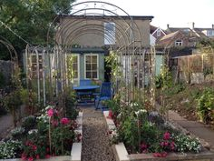 Have planted climbing roses, clematis and wisteria to grow over the arches. Can hardly wait until next year!