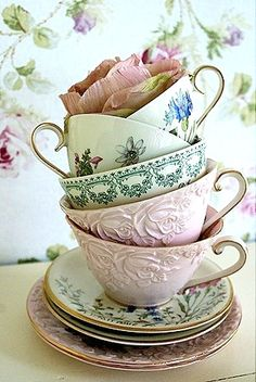 T e α . T i m e - collection of tea cups