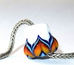 Luccicare Lampwork Bead -  BIG Rainbow Lotus on White - Focal -  Lined with Sterling Silver by Luccicare on Etsy