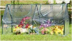 "Homewell Compact Greenhouse Cloche 71""L x 36""D x 36""H Homewell http://www.amazon.com/dp/B00U9RFYQO/ref=cm_sw_r_pi_dp_.xF-vb061CVHN"