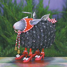 Patience Brewster - Barbara Black Sheep Ornament Dimensions: 5 Inches Barbara Black Sheep does not always follow the crowd. This girl knows a smart path when she see's one! Silver wings and Halo shining, she's out in front.